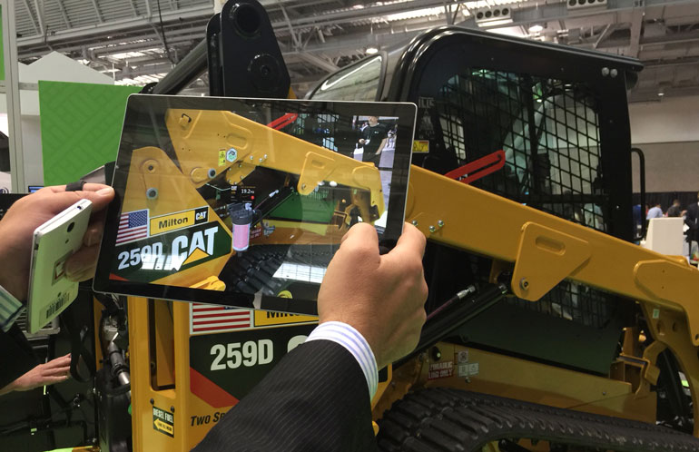 Demo of augmented reality monitoring of an excavator. Photo via Caterpillar