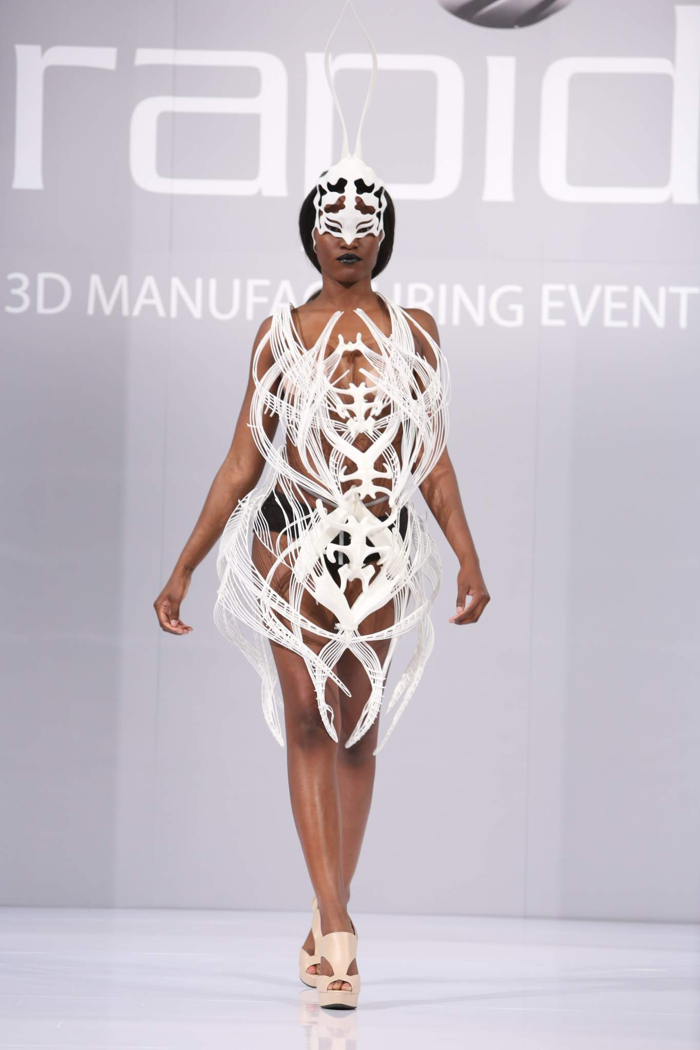 The RAPID 2016 3D Fashion Show featured 3D printed designs from several fashion designers. Photo via SME.