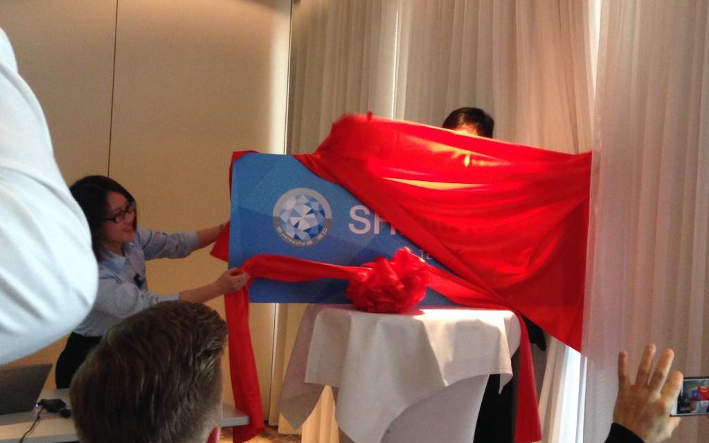 Unveiling of the Shining3D EMEA office sign by director Sunny Wong. Photo by Beau Jackson for 3D Printing Industry