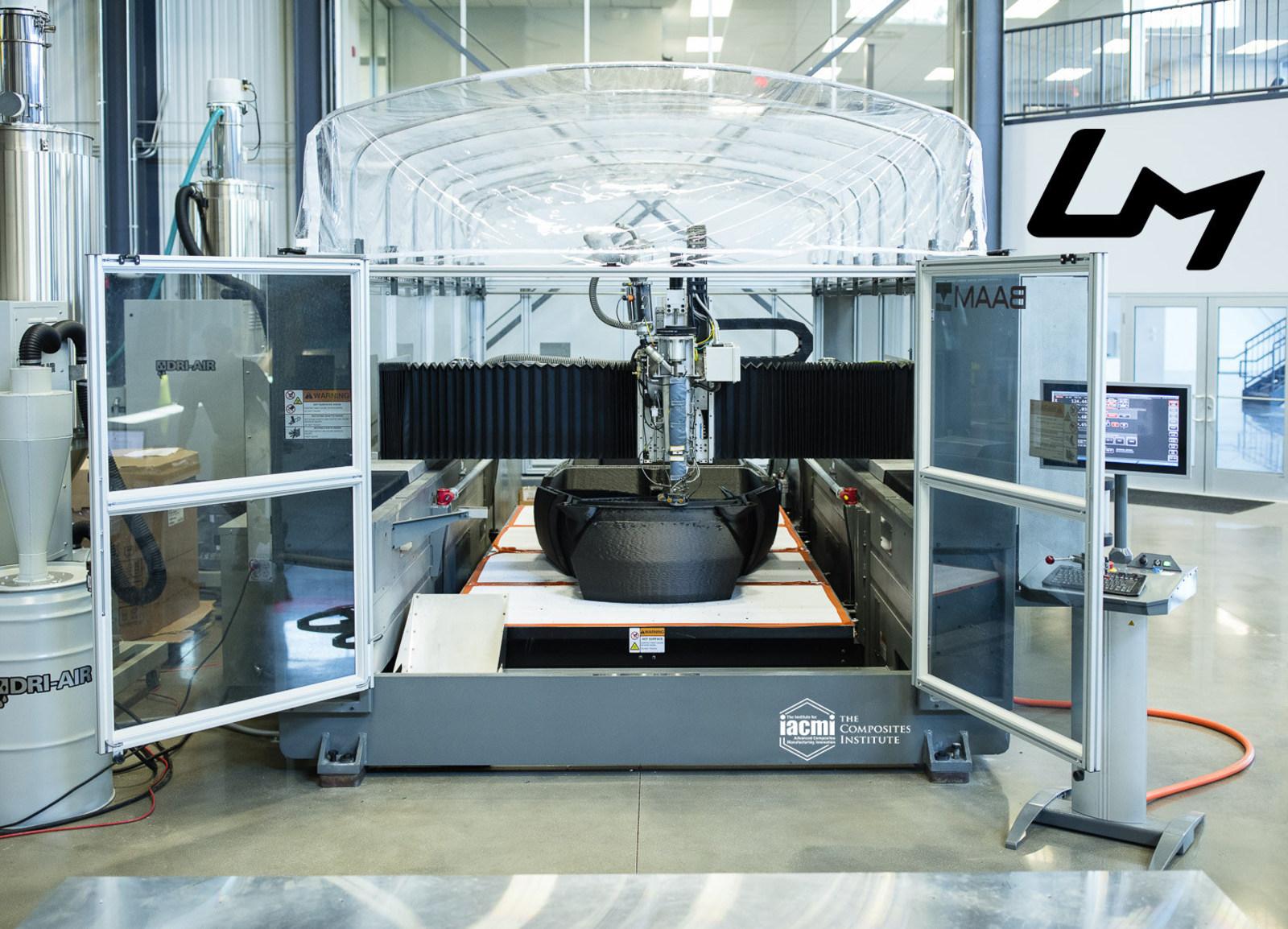 ORNL's A Big Area Additive Manufacturing (BAAM) machine in use to print the Strati car. Photo via IACMI