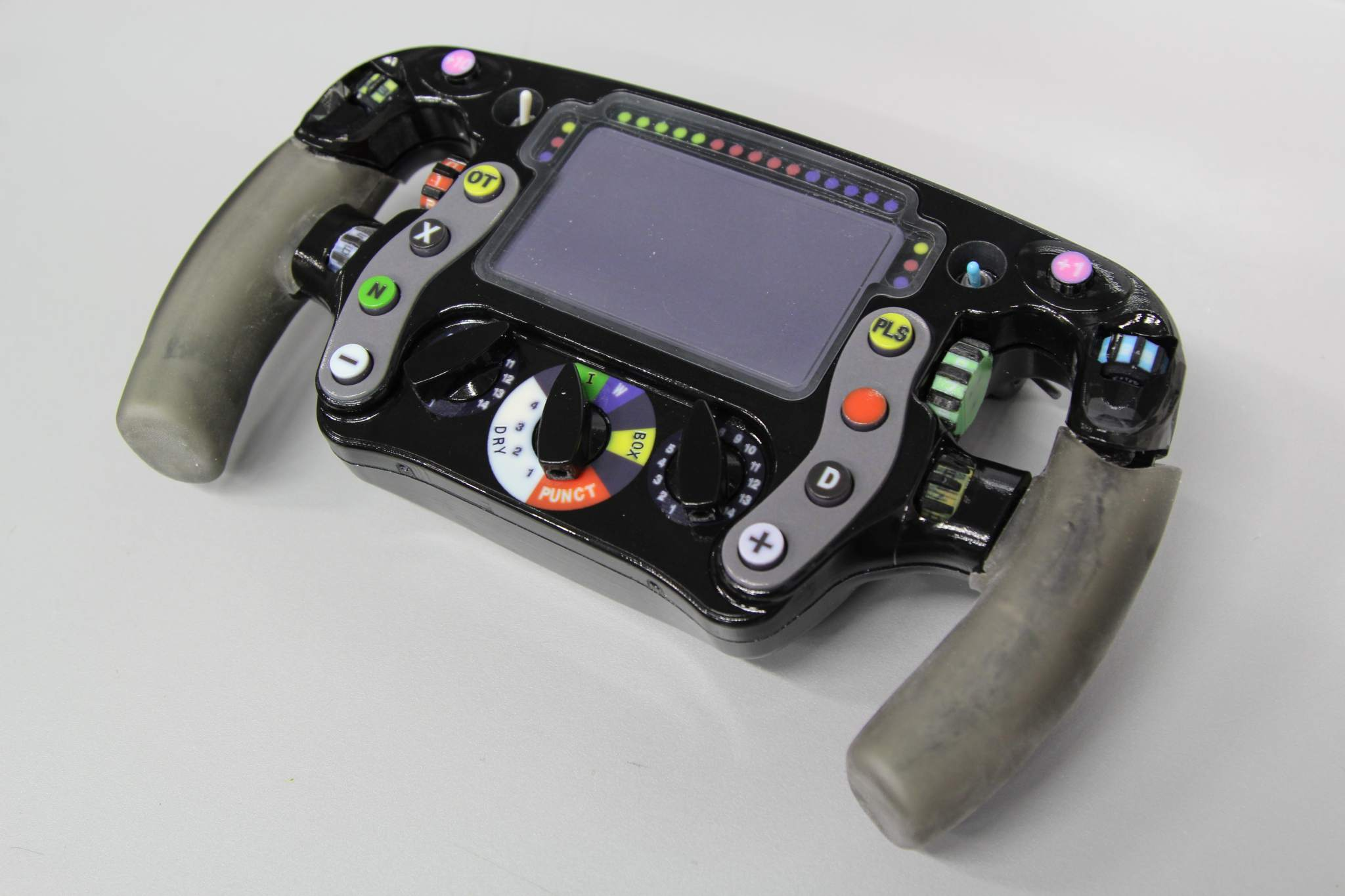 3D printing was used to prototype the steering wheel and map the buttons. Photo via Stratasys.