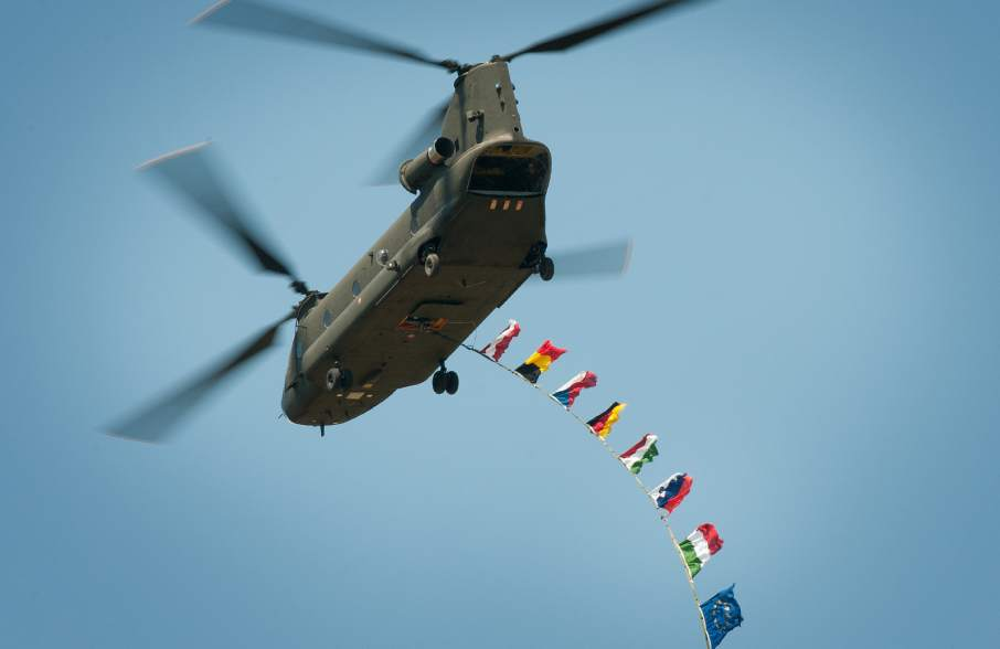 Italian Blade helicopter flying European flags. Photo by the Austrian Armed Forces/Horst Gorup via eudefenceagency on Flickr.