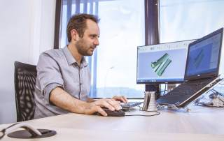 Materialise software serves as the backbone for the 3D printing process, allowing users to optimize designs, prepare files and manage production processes
