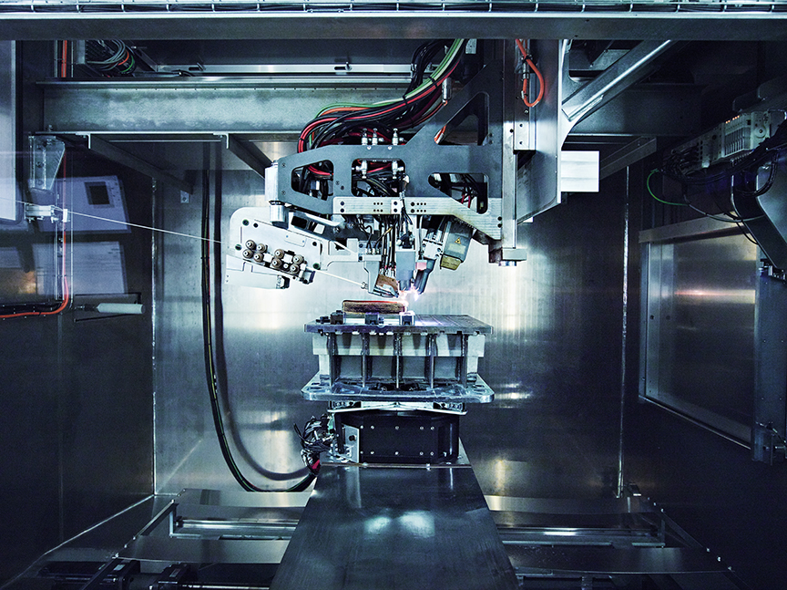 Additive manufacturing the components inside a Merke IV Rapid Plasma Deposition™ machine. Photo via Norsk Titanium