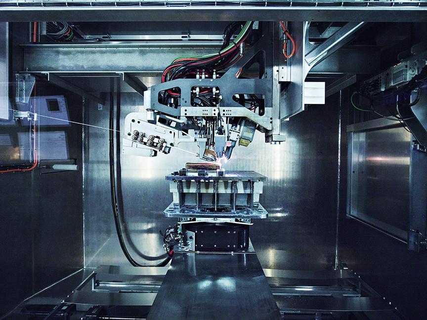 Additive manufacturing the components inside a Merke IV Rapid Plasma Deposition™ machine. Photo via Norsk Titanium