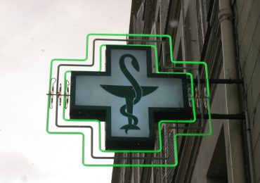 The European Bowl of Hygeieia symbol on a cross marking a pharmacy in Paris. Photo by Pat Guiney, mrmystery on Flickr