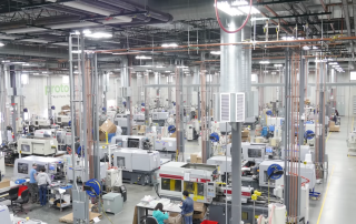 Injection molding machines at their Plymouth facility. Screenshot via Proto Labs.