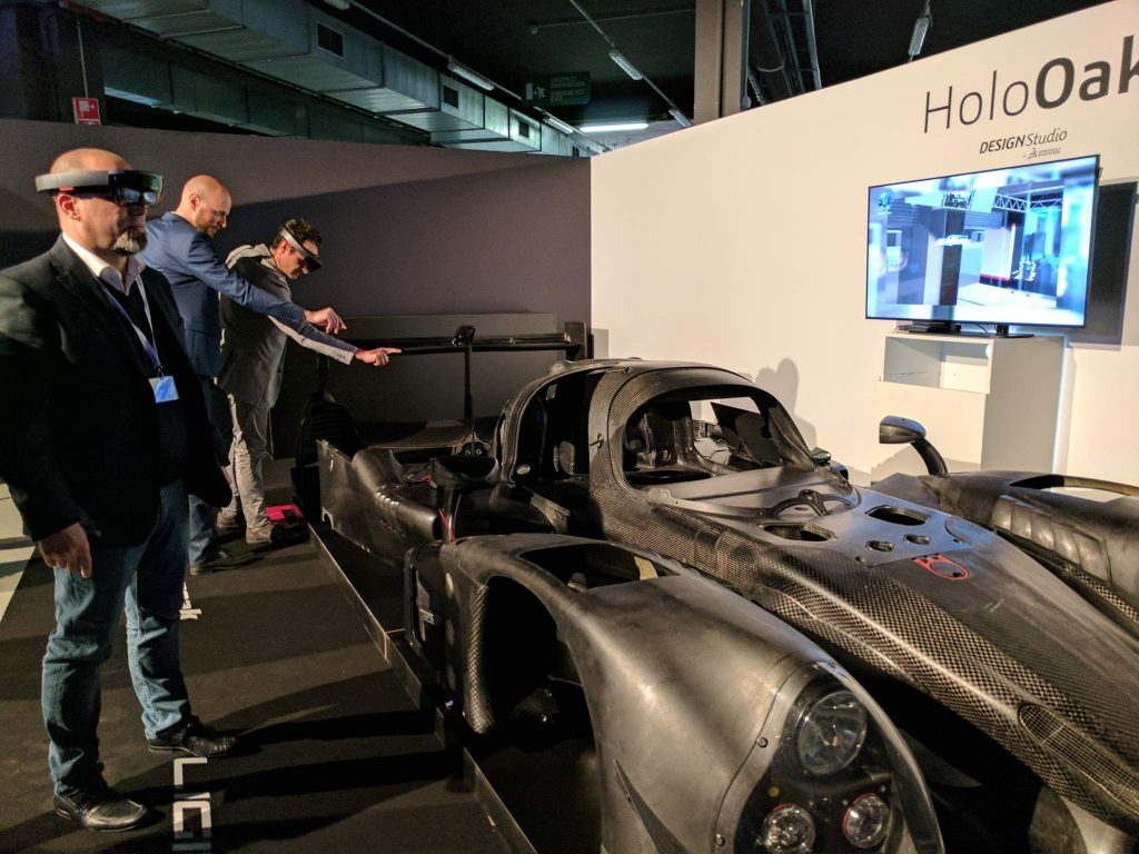 Vistors at the Dassault Systemes Design in the Age of Experience conference using the Holo Lens to simulate working as a Formula One engineer. Photo by Michael Petch.