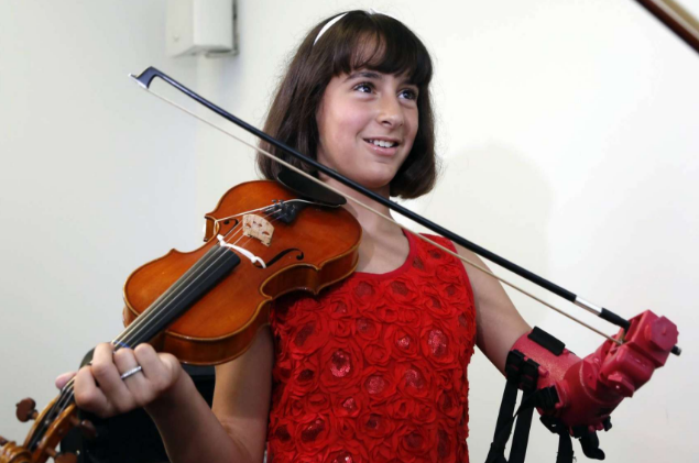 Isabella Nicola Cabrera and her 3D printed prosthetic. Photo via Steve Helber.