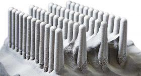 Metal 3D printed hip stems from Arcam. Photo via Arcam.