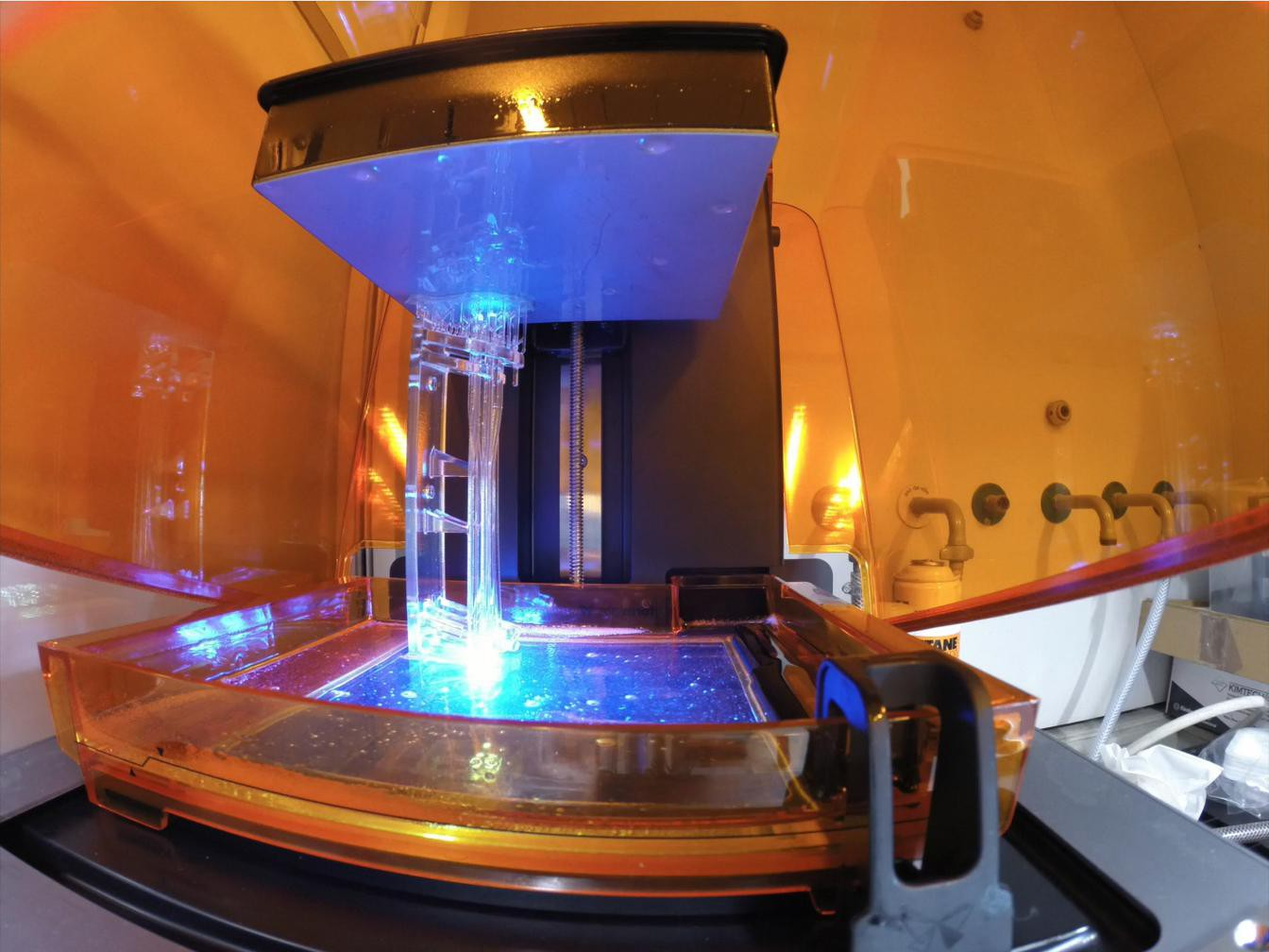 The stereolithography 3D printing process. Photo via A. Osterwalder/EPFL.