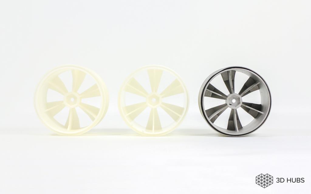 A metal part and its FDM 3D printed equivalents. Photo via 3D Hubs.