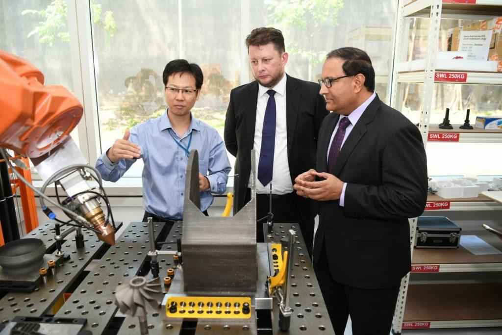 Matthew Waterhouse (centre) at the opening of 3D Metalforge's $1.8 million facility in Singapore. Photo via 3D Metalforge.