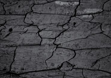 Cracks in natural clay. Photo by Olli Jalonen, 15113531@N02 on Flickr