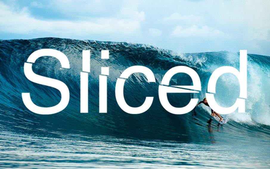 Sliced logo over Professional surfer Mick Fanning riding a barrel wave in 2010. In this edition of Sliced, Fanning rides a 3D printed surfboard developed by Red Bull. Original photo via buro247