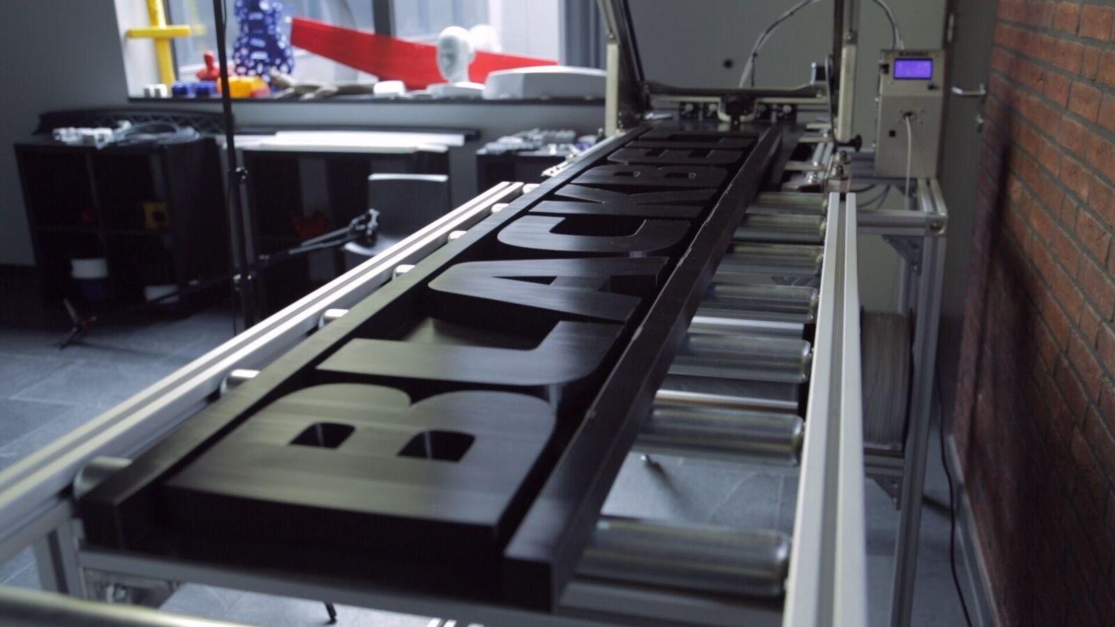 The machine is perfect for creating large horizontal parts like signs. Photo via Blackbelt.