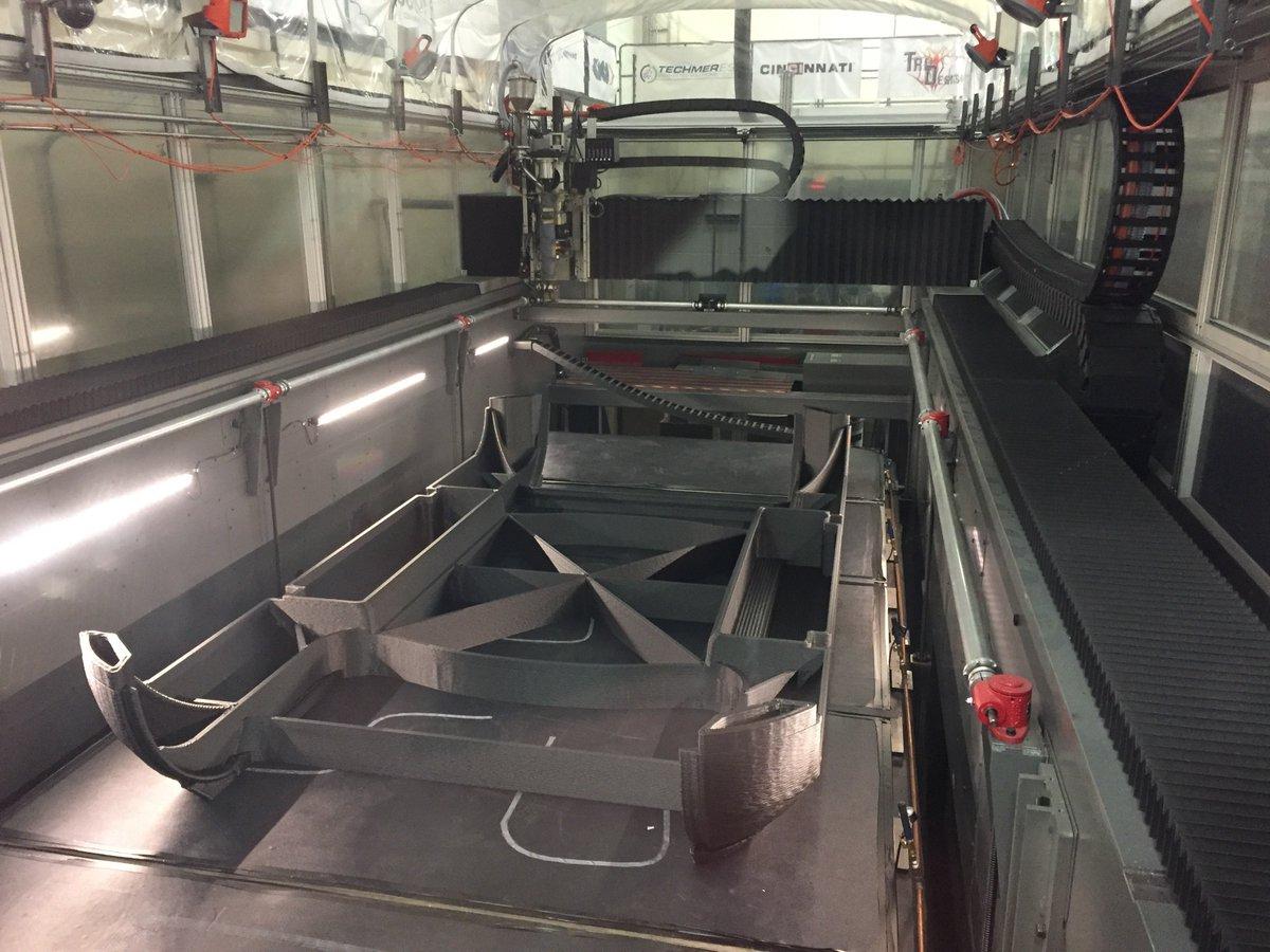 The vehicle being 3D printed on a Cincinnati machine. Photo via Local Motors.