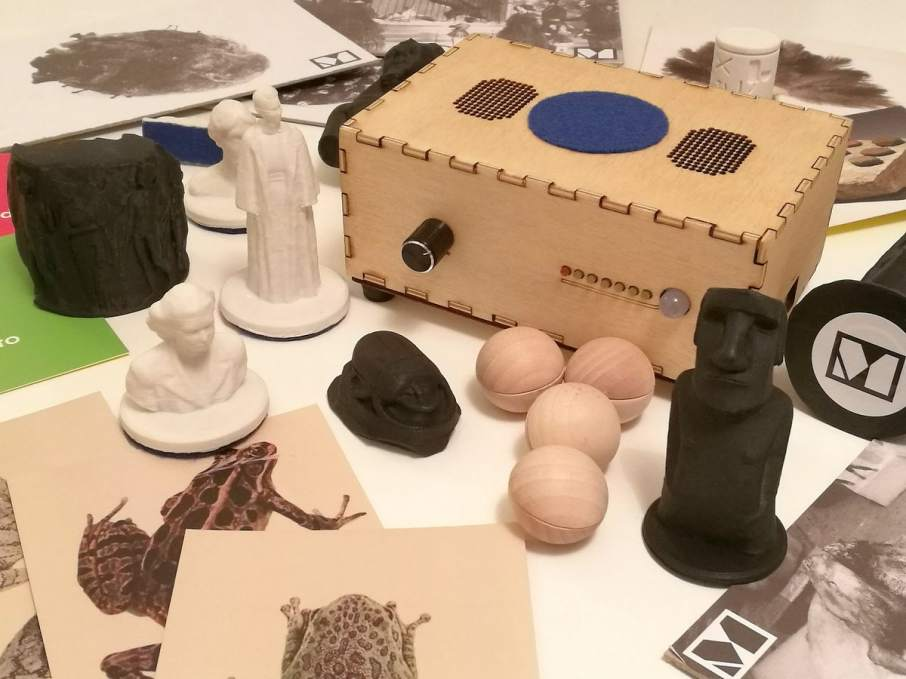 A Museum in a Box and collection of interactive objects. Including a 3D printed Moai figurine, wooden spheres relating to the Planets Suite by Gustav Holst, and 3D printed statutes of women found in London. Photo via @_museuminabox on Twitter