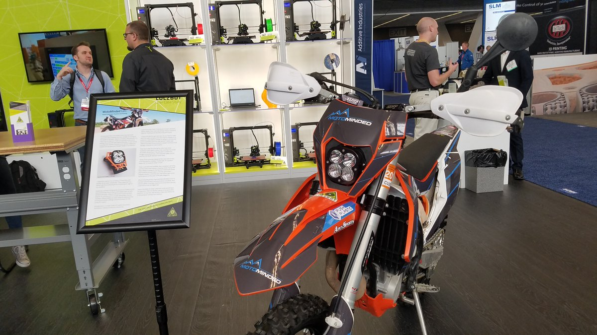 Lulzbot's booth at RAPID, showcasing 3D printed dirt-bike parts. Photo via Lulzbot.