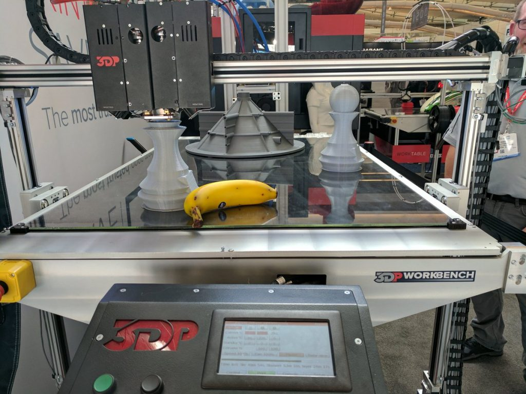 Large 3D printed objects on the 3D Platform Workbench with an (extra large) banana for scale. Photo by Michael Petch
