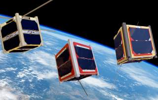 An artist's impression of Cubesats in orbit of the earth. Photo via ESA/Medialab.