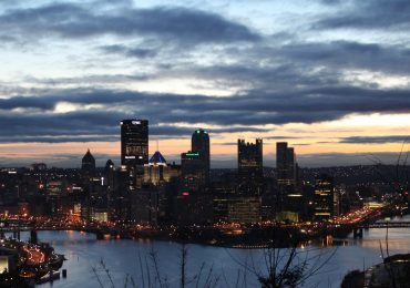 Sunrise over Pittsburgh's skyline. Photo by David Fulmer, daveynin on Flickr