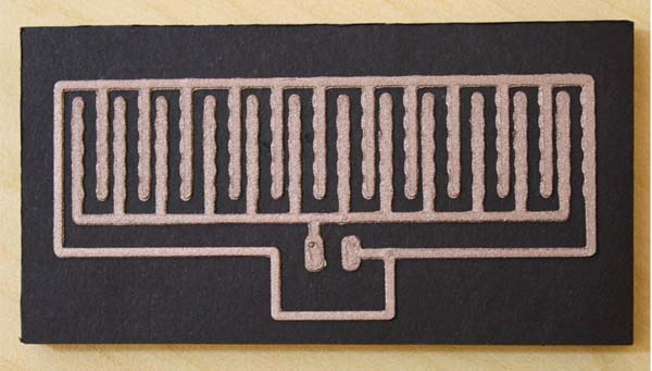 A 3D printed LED nametag circuit on black foam board. Photo via Multi3D.