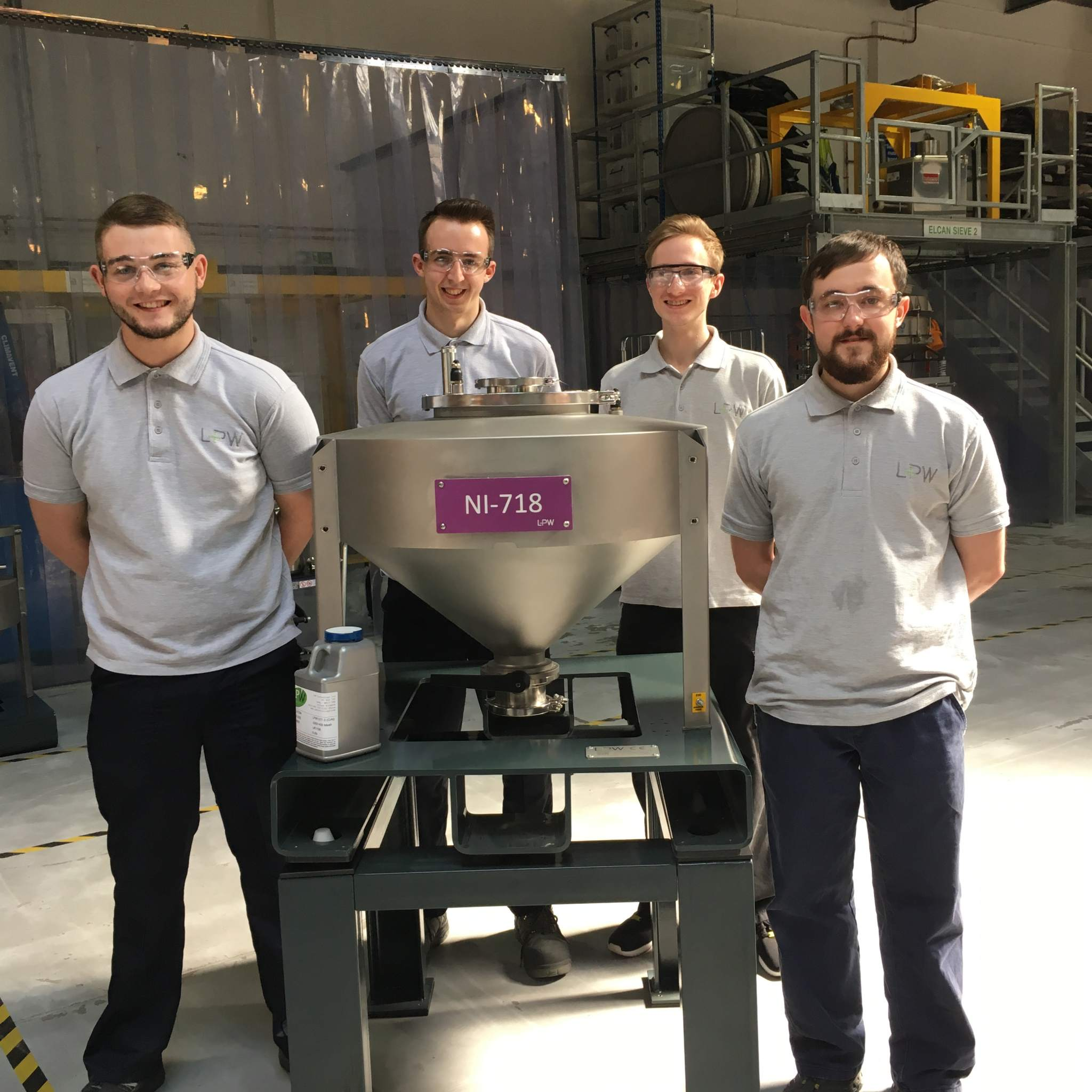 LPW's 2017 apprenticeship team with an original powder container. Photo via LPW Technology.