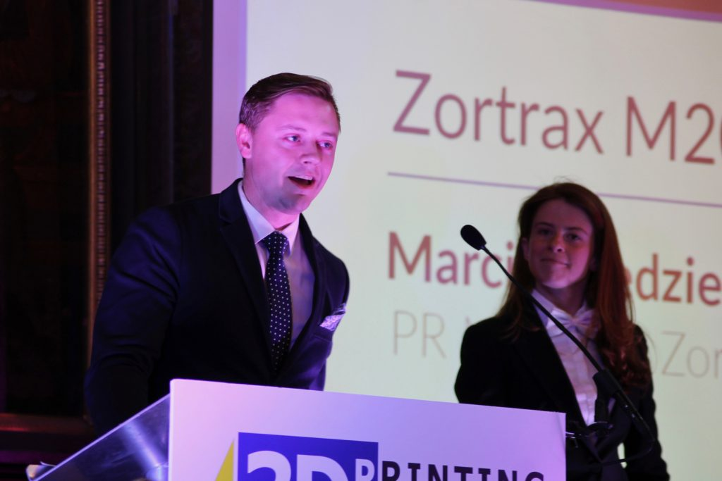 Marcin Niedzielski PR Manager at Zortrax accepting the award for Personal 3D printer of the year (FFF). Photo by Antoine Fargette for 3D Printing Industry.