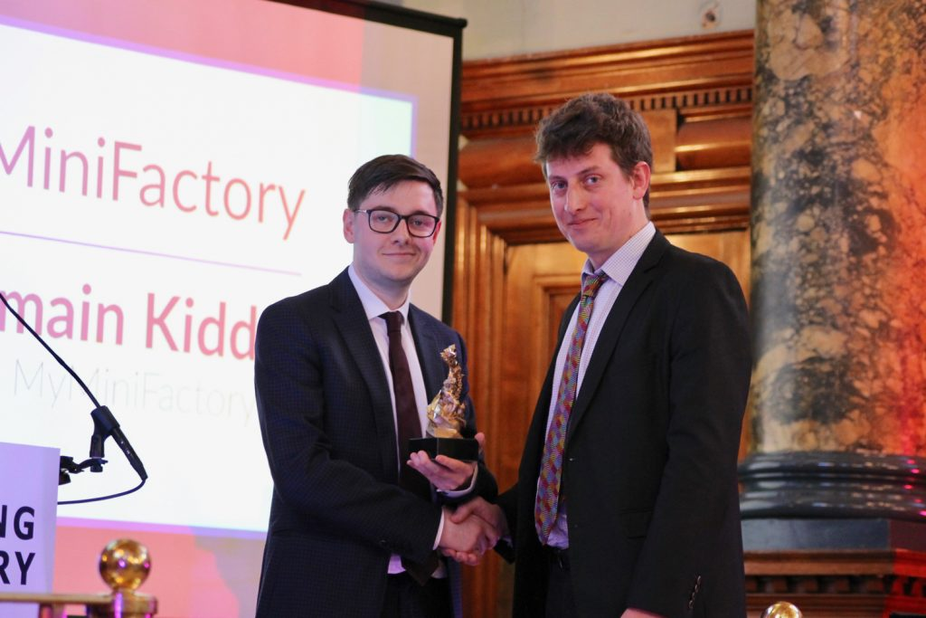 Corey Clarke, senior journalist at 3D Printing Industry (left) presenting the award for sharing platform of the year to Romain Kidd, CEO MyMiniFactory. Photo by Antoine Fargette for 3D Printing Industry.