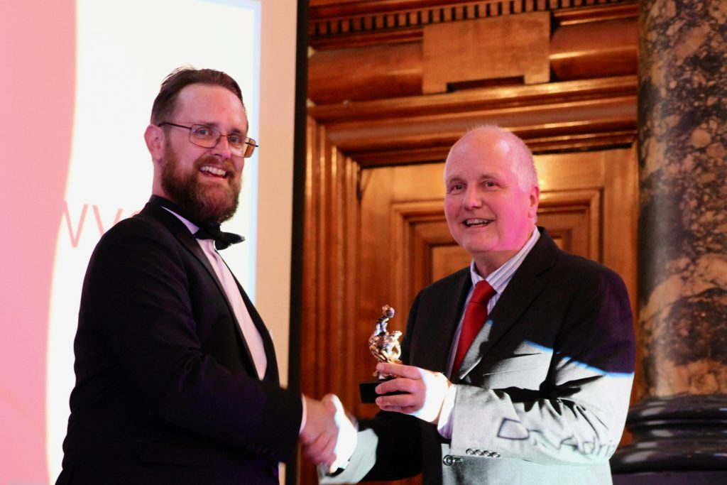 Dr. Adrian Bowyer (right) receives the award for Outstanding Contribution to 3D printing from Michael Petch (left) Photo by Antoine Fargette for 3D Printing Industry.