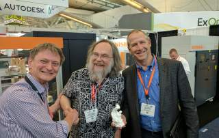 Jim Martin from Sesame Street and Renishaw with the 3D Printing Industry Award. Photo by Michael Petch