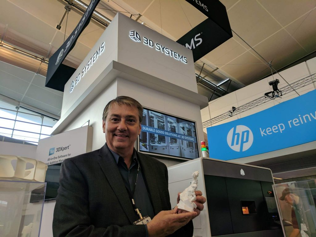 Jim Ruder of 3D Systems with the 3D Printing Industry Award. Photo by Michael Petch.
