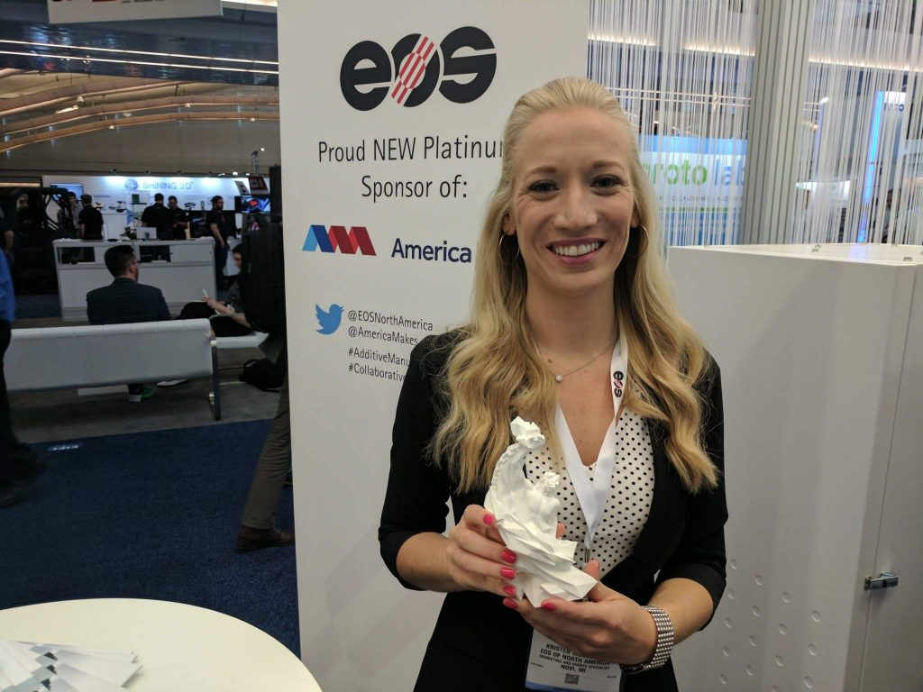 Kristen Eisiminger from EOS with the 3D Printing Industry Award. Photo by Michael Petch.