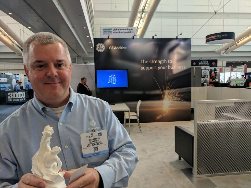 Mike Cloran from GE Additive with the 3D Printing Industry Award. Photo by Michael Petch.