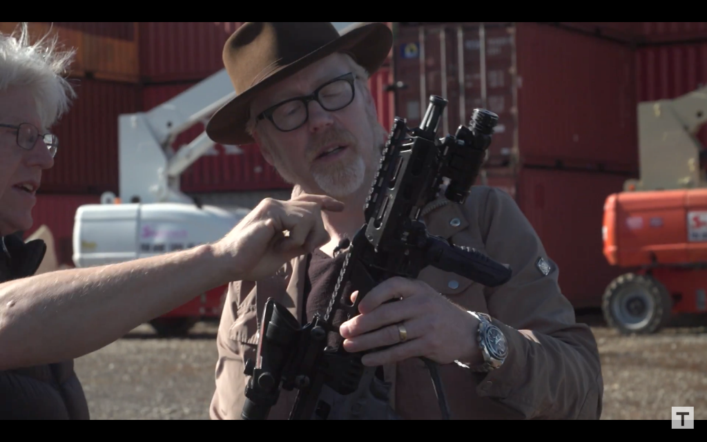 Tested's Adam Savage (right) sees the 3D printed rail on a rifle for the Alien: Covenant film. Screenshot via Tested on YouTube