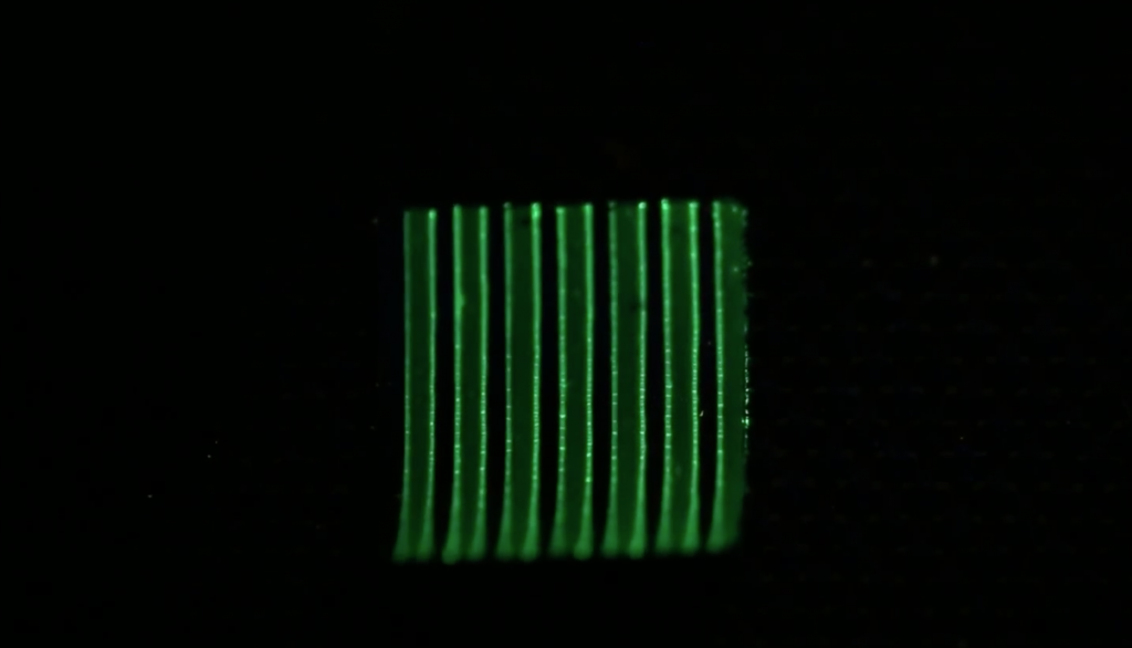 Glowing strips of 3D printed bacteria microbes when humidity is increase. Screenshot via Science Advance, supplementary videos