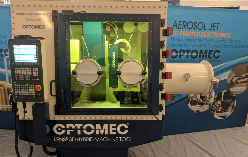 The Optomec LENS 3D Hybrid Machine Tool at RAPID + TCT. Photo by Michael Petch.
