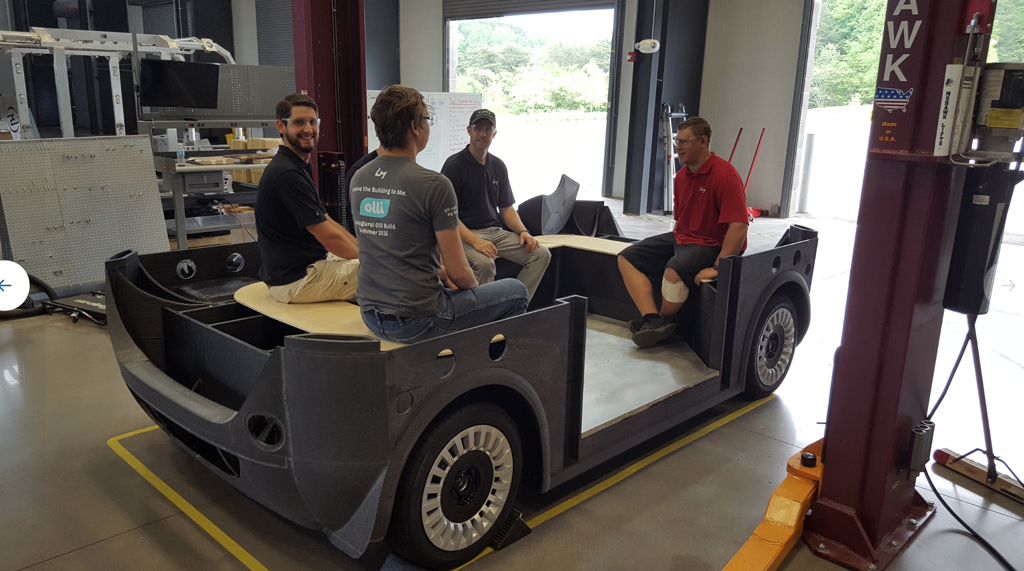 The Local Motors team testing the shuttle out for size. Photo via Local Motors.