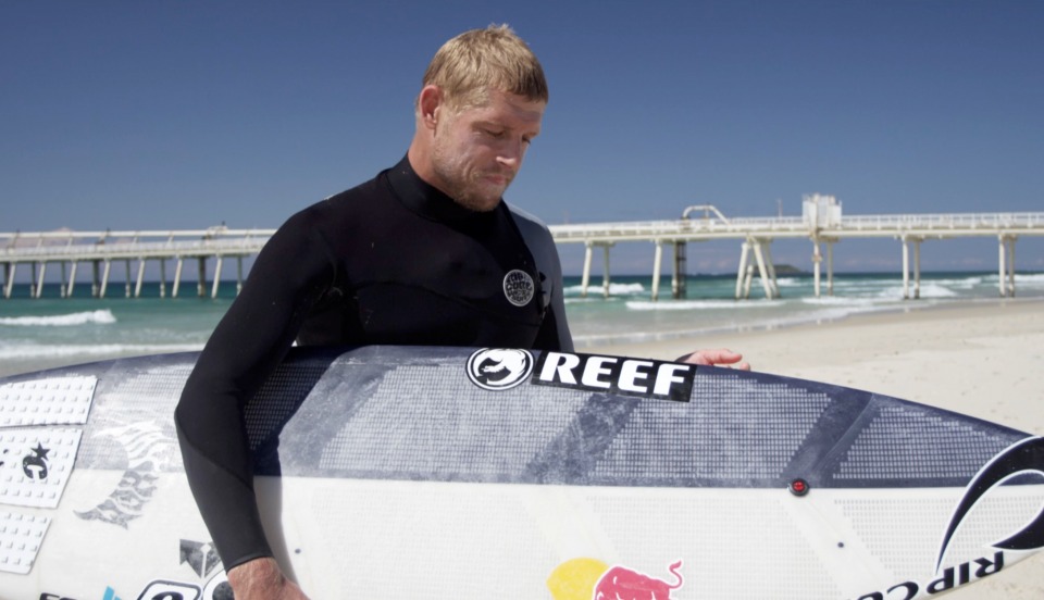 Mick Fanning and the Red Bull 3D rented surfboard prototype. Photo via the Red Bulletin