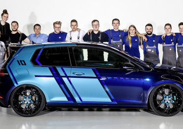 The VW Golf GTI First Decade model and apprentices who worked together to make it. Photo via Volkswagen