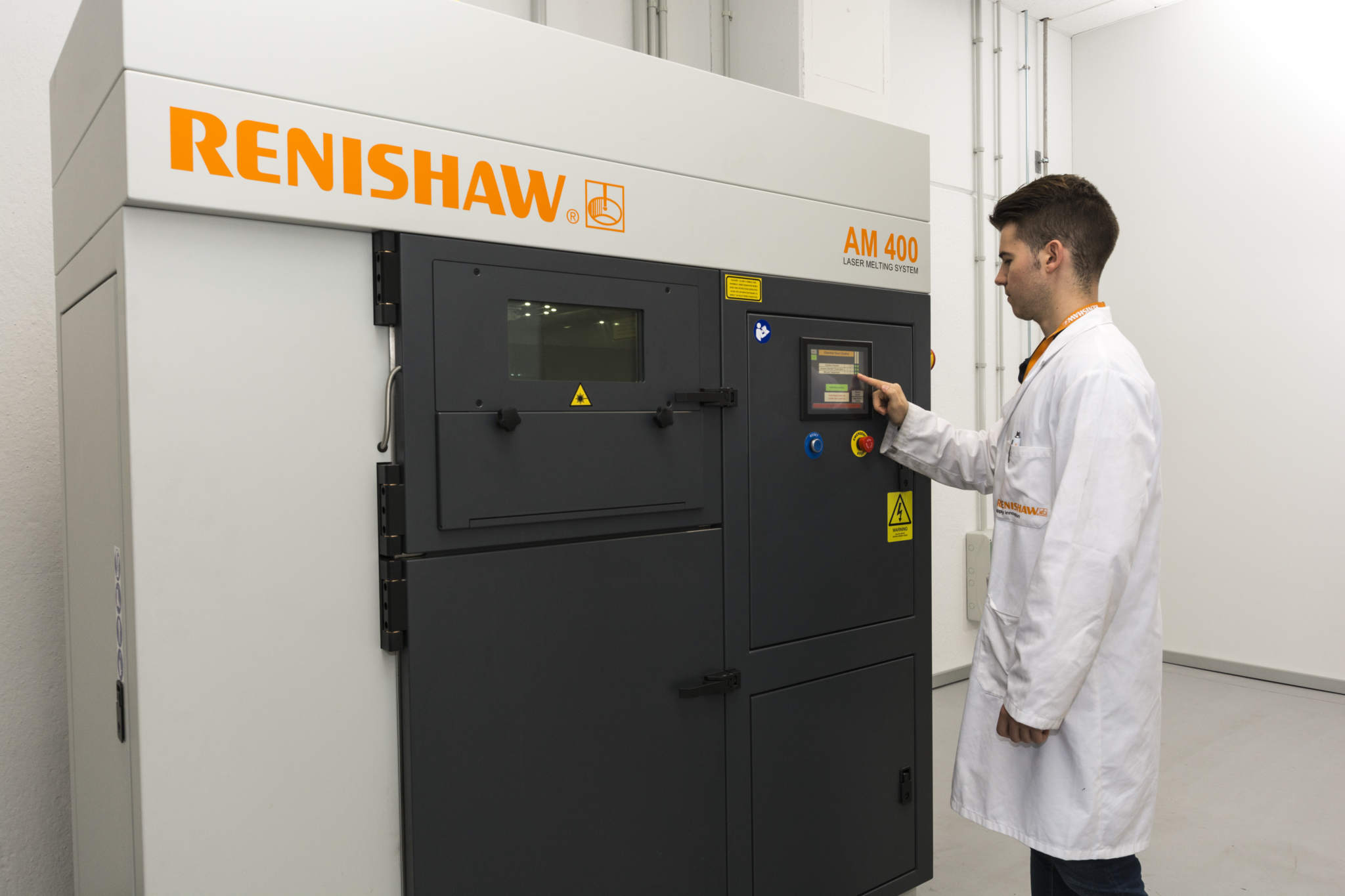 Alex Garcia, Additive Manufacturing Design and Applications Engineer at Renishaw Iberica with the RenAM 400. Photo via Renishaw.