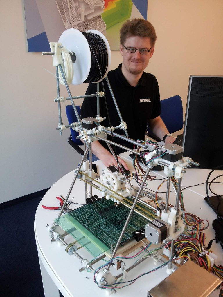 Pawel and his optomized RepRap 3D printer