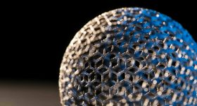 A 3D printed metal mesh ball. Photo via GE Additive