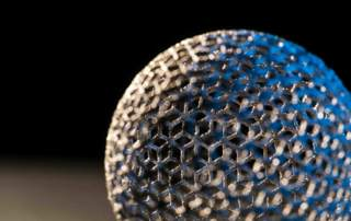 A 3D printed metal mesh ball. Photo via GE Additive