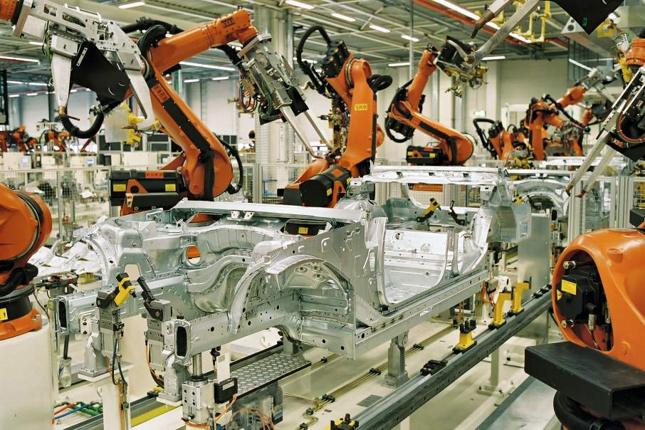 KUKA robotic arms providing spot-welding at BMW Leipzig. One automated part of Industry 4.0. Photo via BMW Werk Leipzig - bmw-werk-leipzig.de