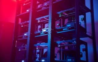 Voodoo Manufacturing's wall of 3D printers. Image via Voodoo Manufacturing.