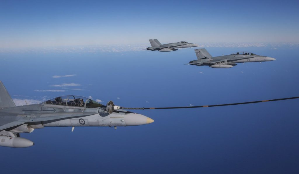 """An F/A-18B Hornet during air-to-air refuelling with a KC-30A Multi-Role Tanker Transport during Exercise Diamond Shield."" Photo via @DeptDefence on Twitter"