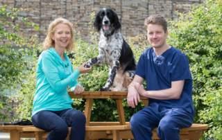 Owner Fiona Kirkland with dog, Eva and surgeon William Marshall. Photo via University of Glasgow.