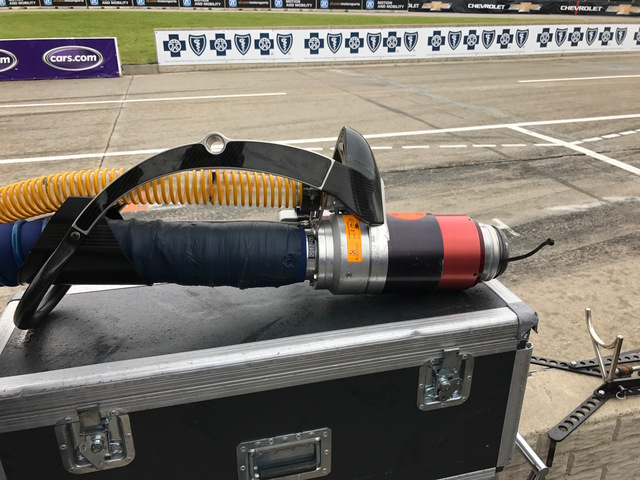 The 3D printed fuel line hose handle. Photo via WXYZ.